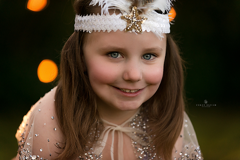 Little girl smiles at the camera near Red Deer Alberta